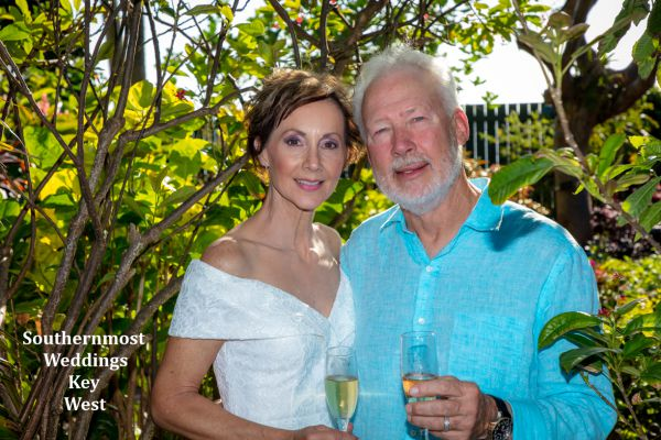Wedding couple celebrate their wedding by Southernmost Weddings Key West with some champagne