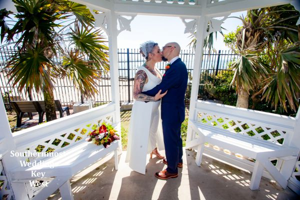 Wedding couple kisses in the Gazebo of the West Martello Towers after their elopement planned by Southernmost Weddings Key West