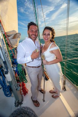 Wedding couple enjoy their private sunset sailboat wedding planned by Southernmost Weddings