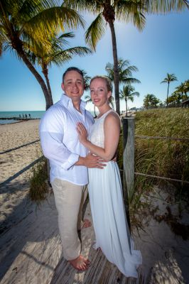 Wedding couple on Smathers Beach in Key West, Florida after their elopement by Southernmost Weddings