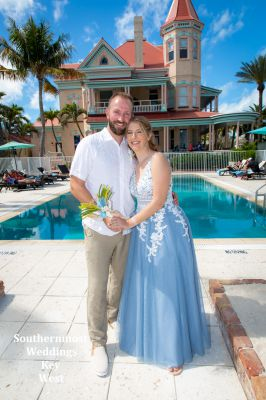 Wedding couple pose for photos at the Southernmost House in Key West