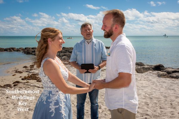 Wedding officiant marries a couple on Smathers Beach in Key West, Florida, Image by Southernmost Weddings