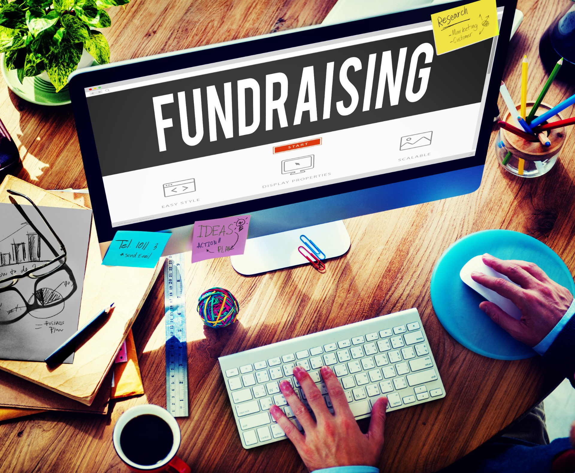 image of a computer screen with the word fundraising across it