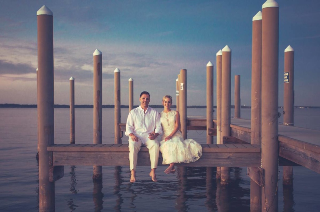 Bride and Groom sitting on a dock