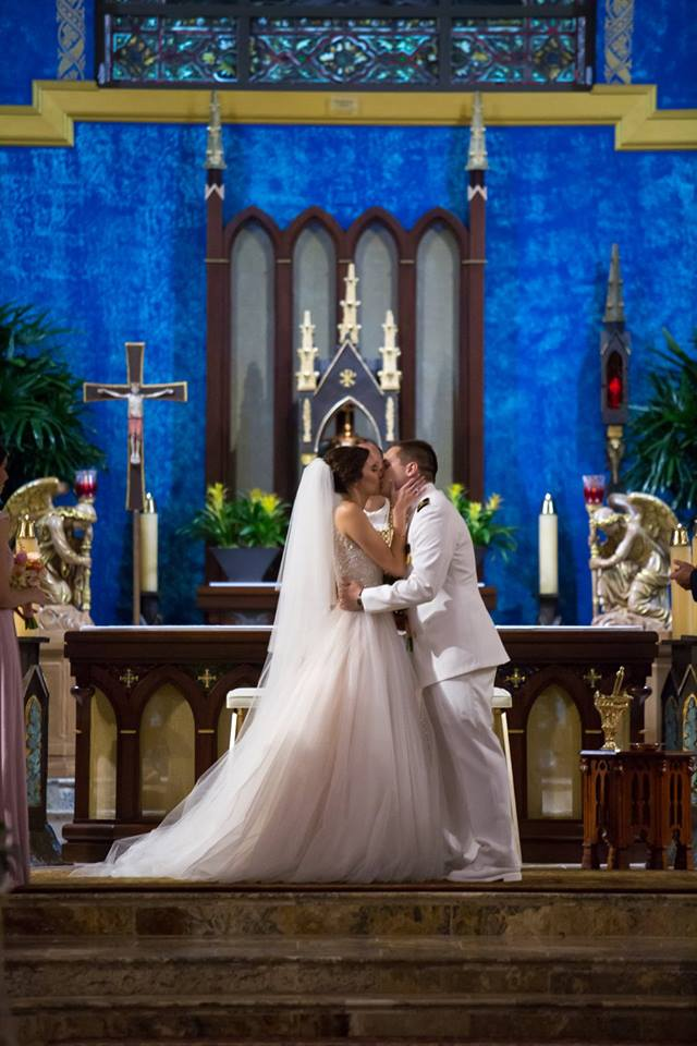 Couple Kissing at the Altar