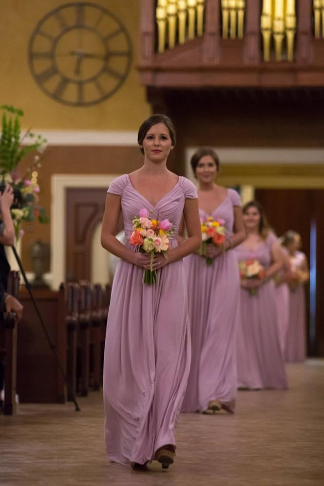 Bridesmaids walking the aisle