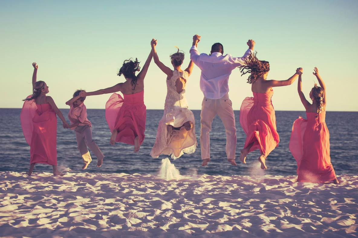 Wedding Party Jumping on Beach