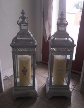 2 very large white vintage lanterns with candles