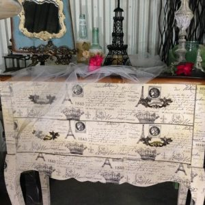 French designed table with three drawers & wood tap. Front to table is made of material with French wording