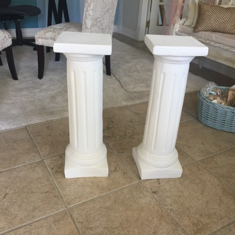 White pedestal columns for wedding plants