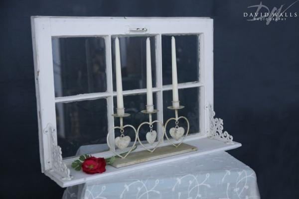 Vintage white window with shelf heart candleabra with candles. Window can be used to write on with crayon marker