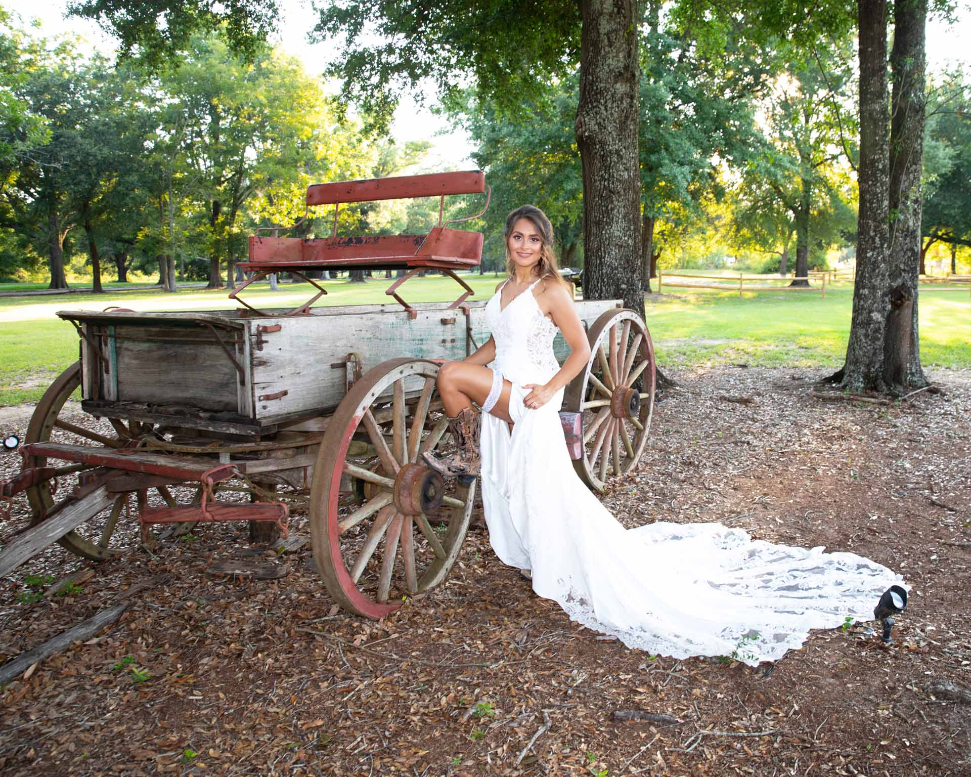 Bride posing next to a wagon
