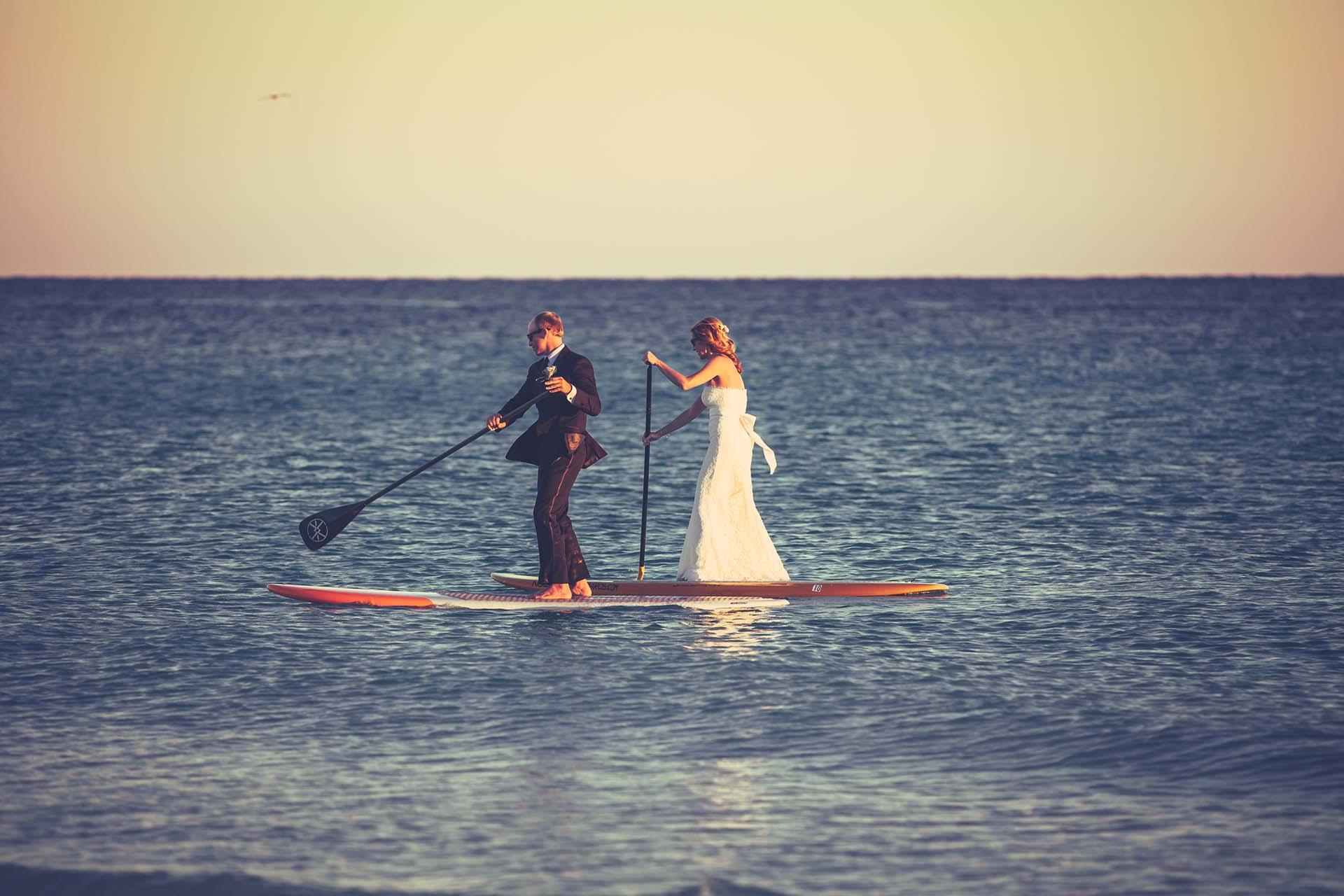 Bride and Groom paddleboarding
