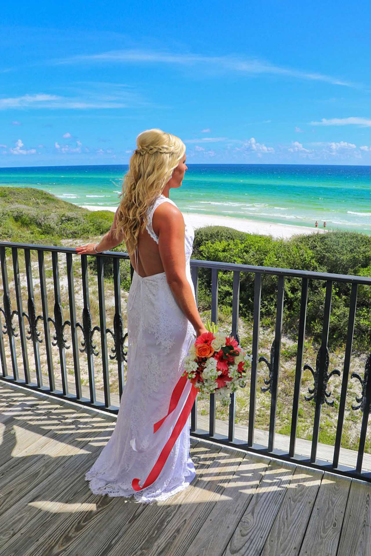 Bride looking at the ocean