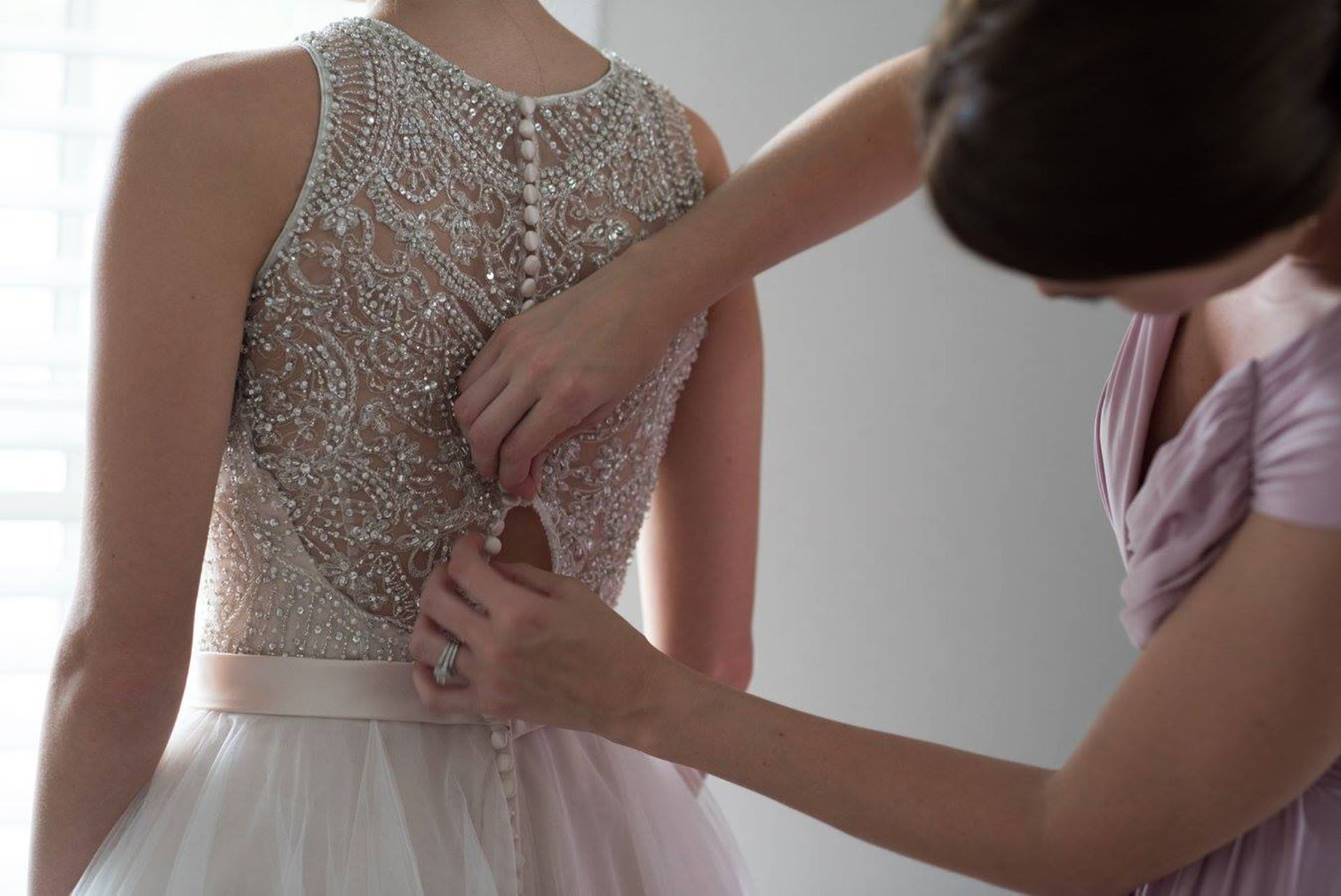 Leslie getting into her wedding dress