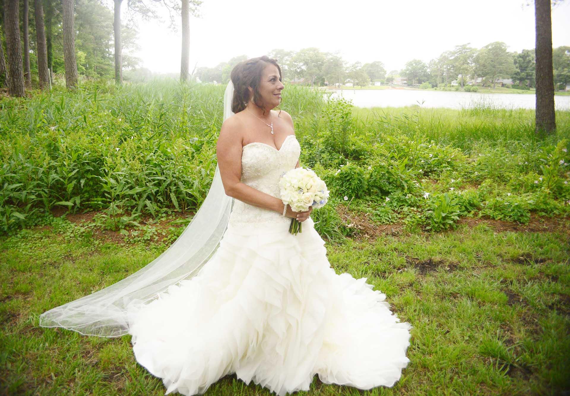 Bride taking wedding photos