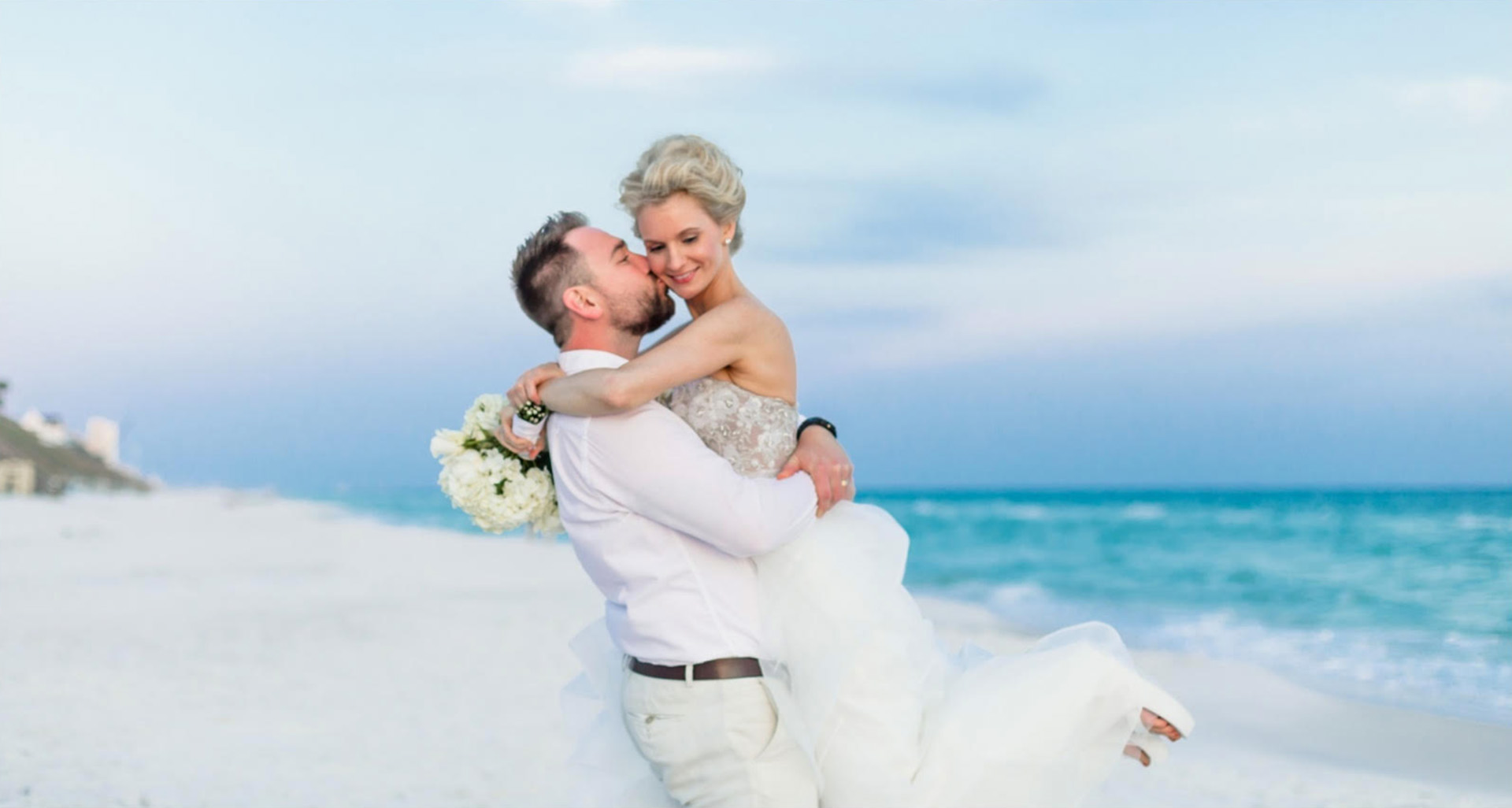 The Wallis' on the beach at their wedding