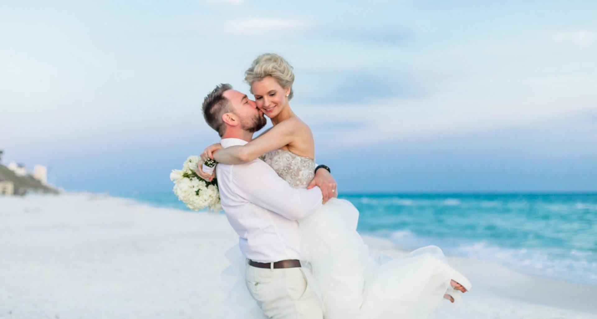 The Wallis' on the beach at their wedding