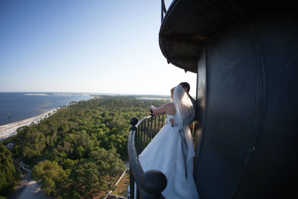 Bride and groom at the top of a lighthouse