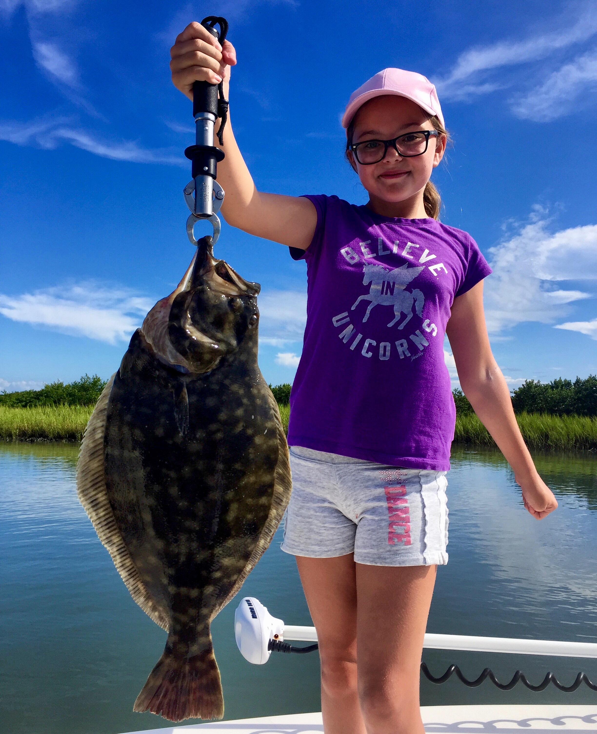 Young Girl Holding Flounder