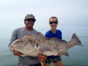 Two people holding a Black Drum