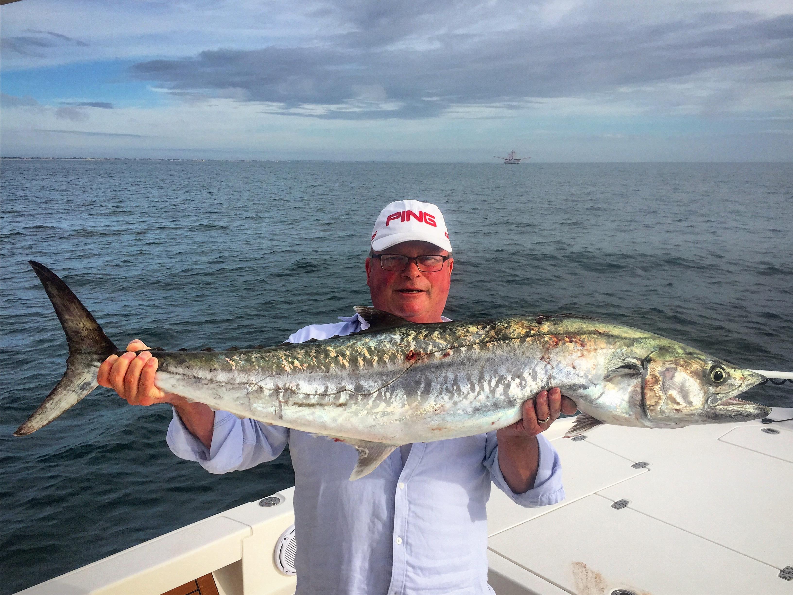 Man holding kingfish