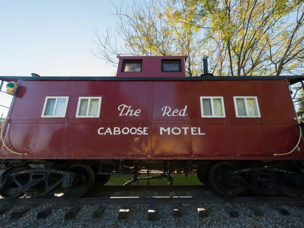 red train caboose featuring big sign for Red Caboose Motel
