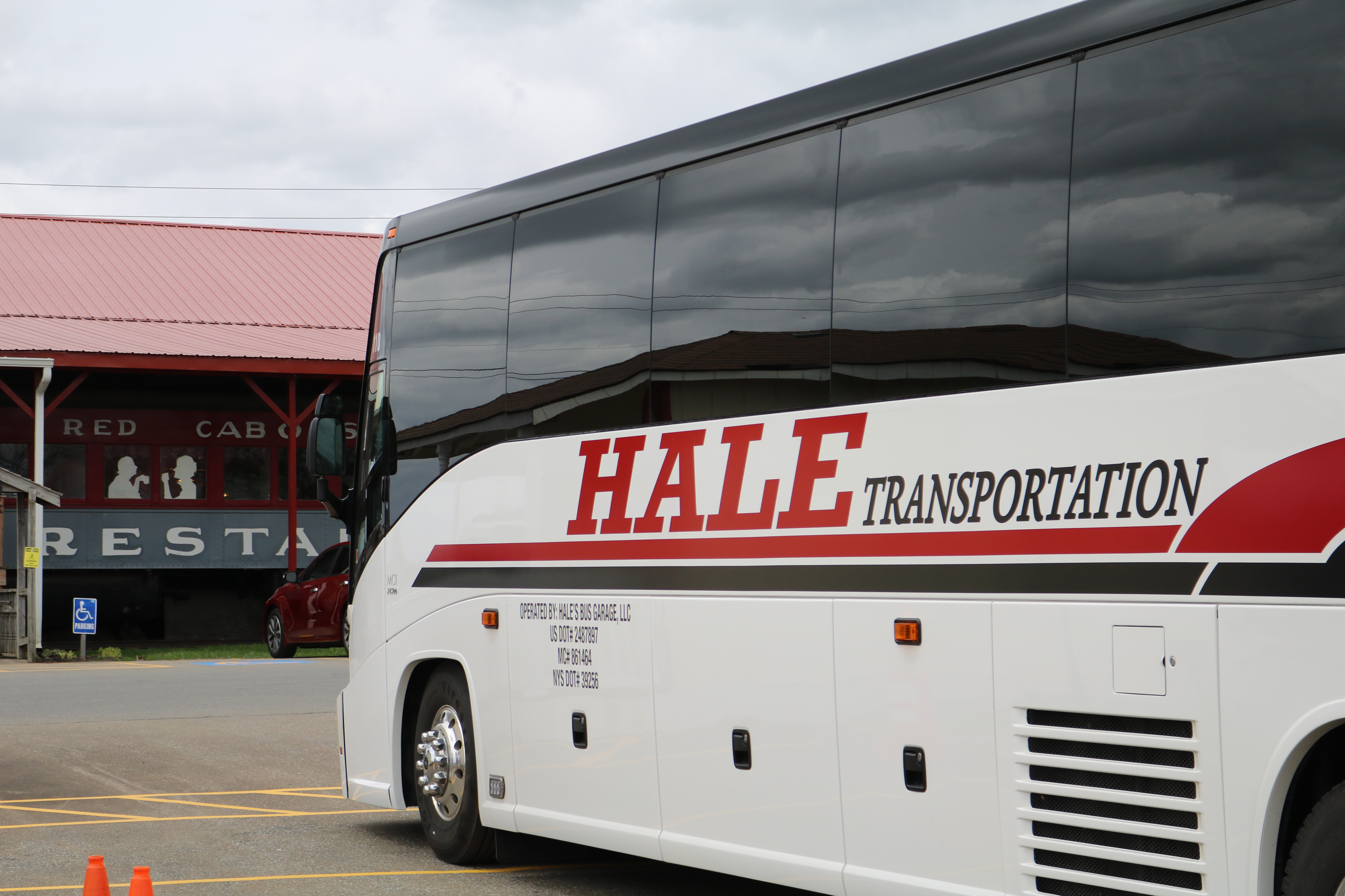 Hale transportation bus in restaurant parking lot