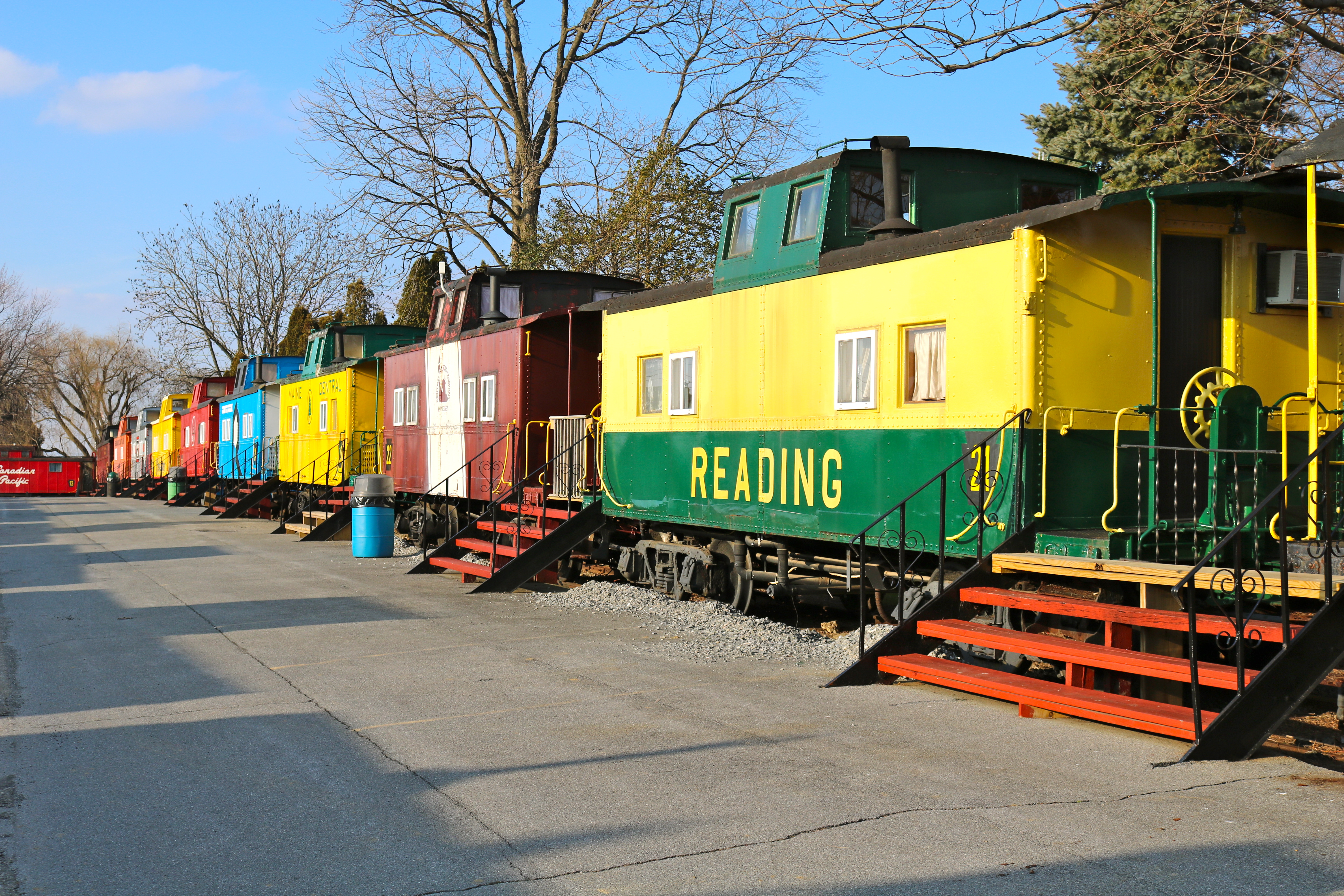 row of colorful cabooses in the daytime