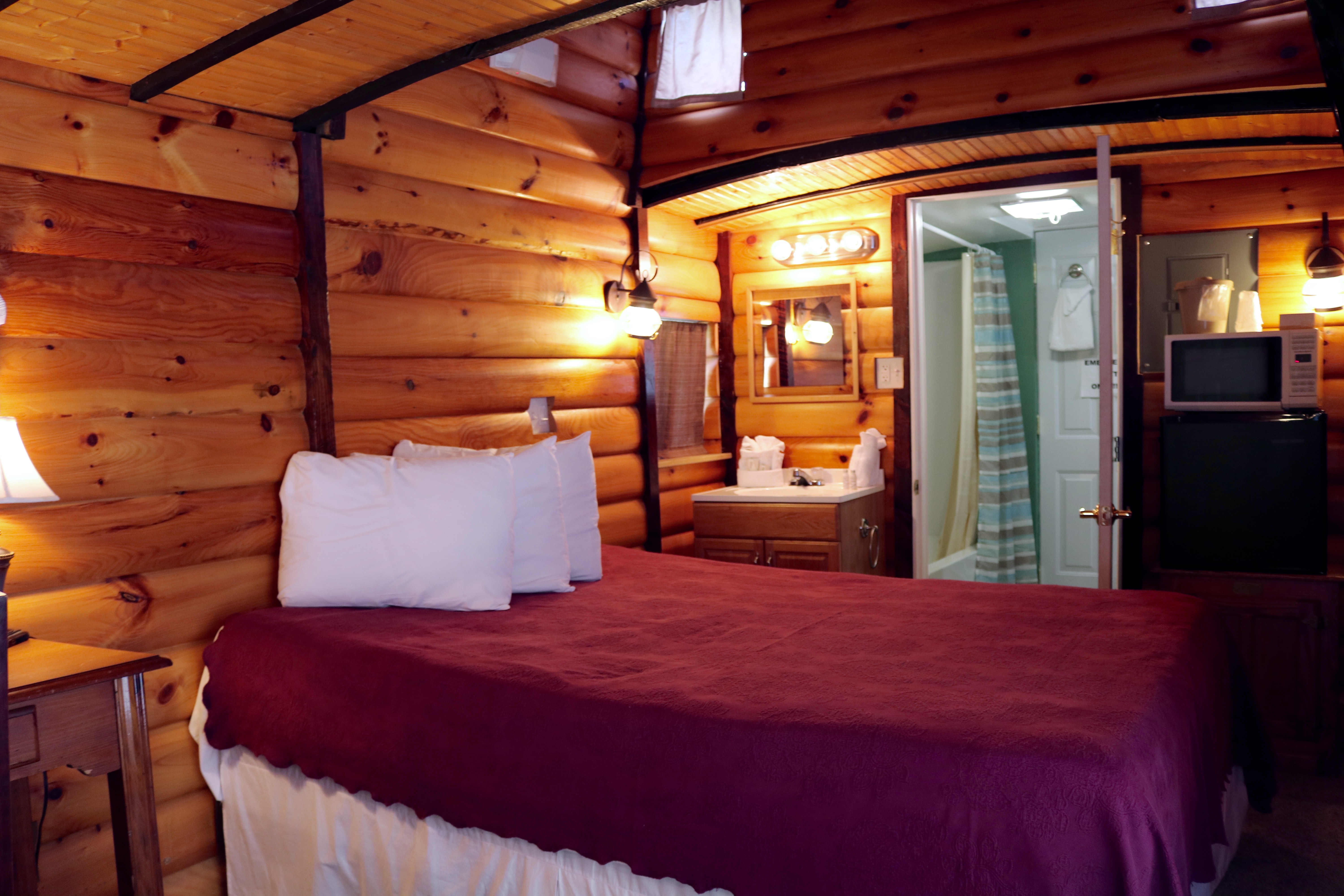 interior view of queen couples caboose motel room