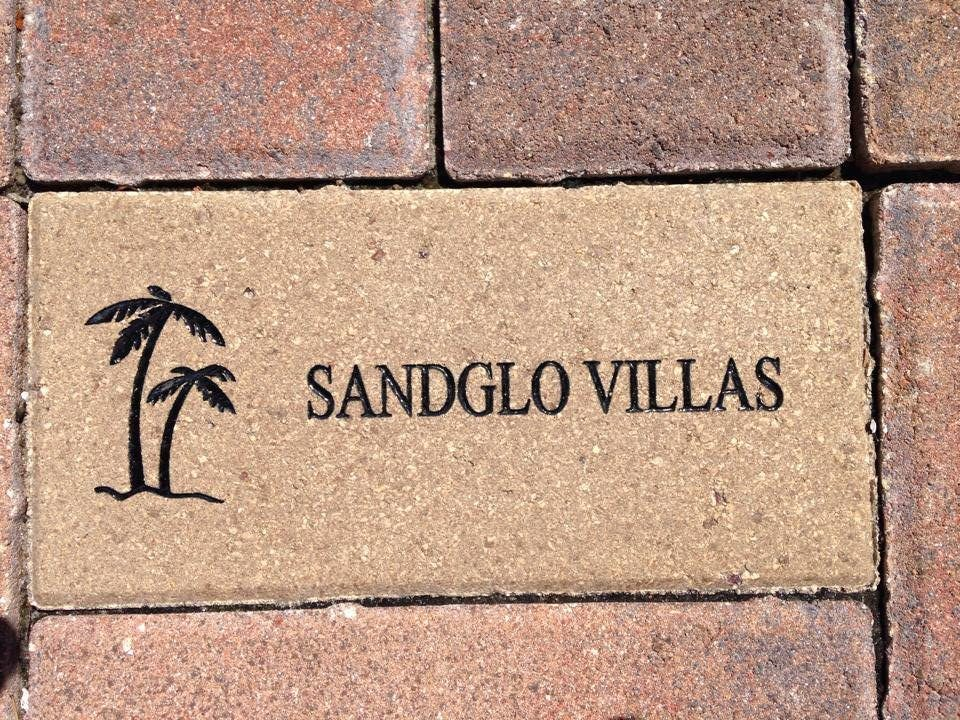 brick with Sand Glo logo etched into it