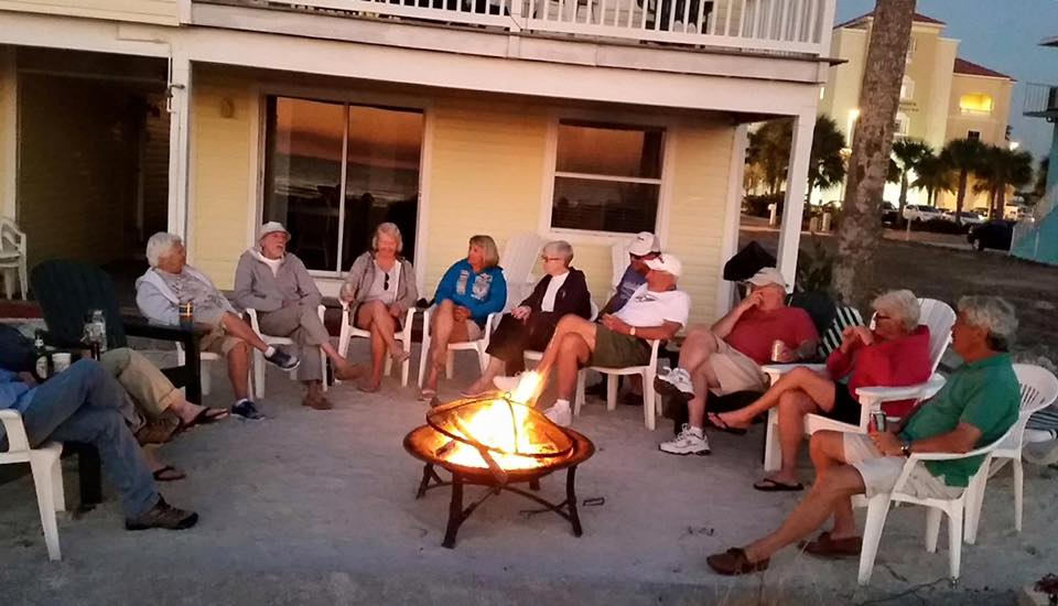 people in chairs around fire pit