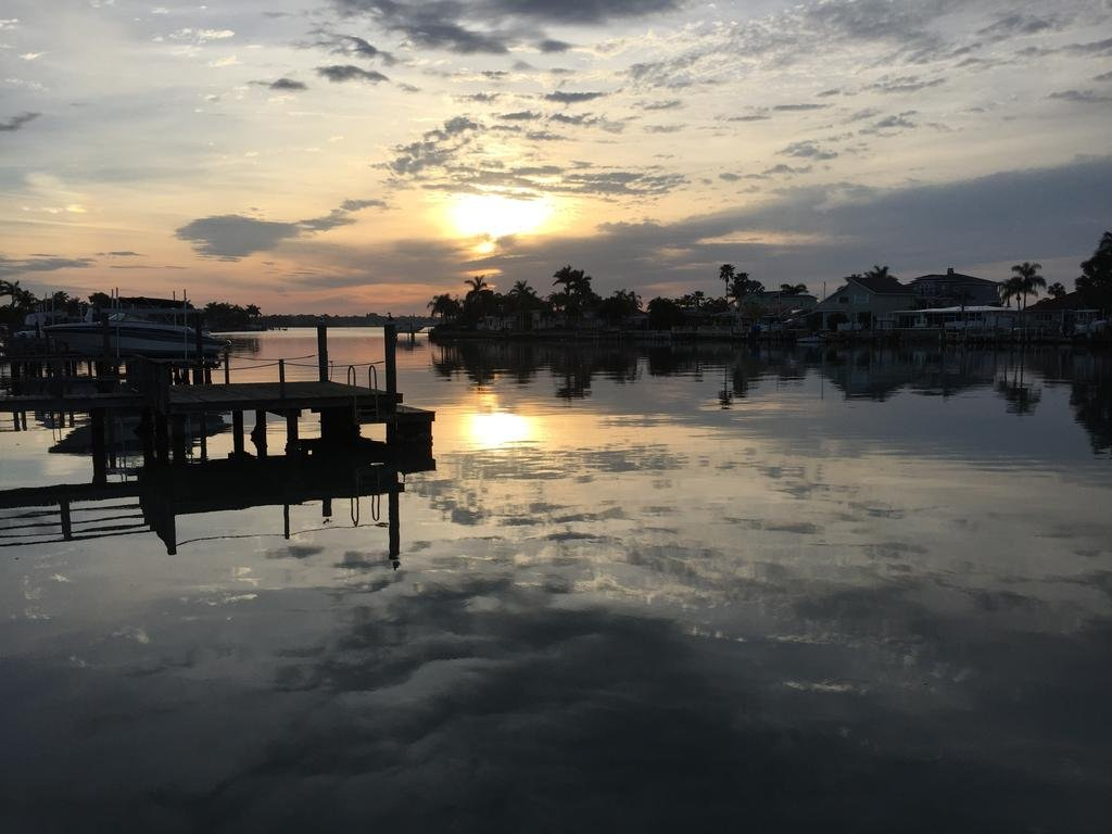 sunset over water with dock