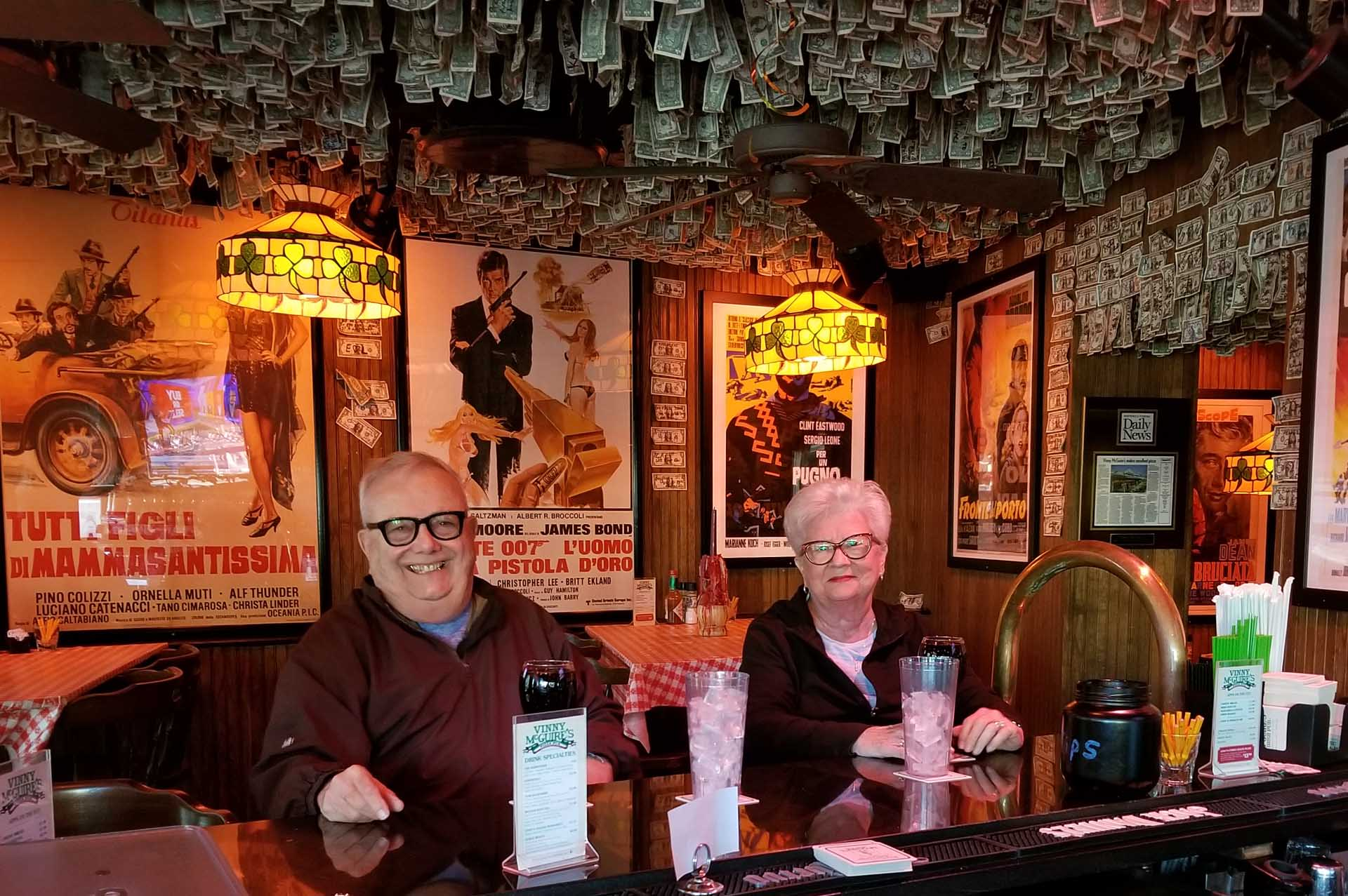 husband and wife seniors sitting at the bar smiling