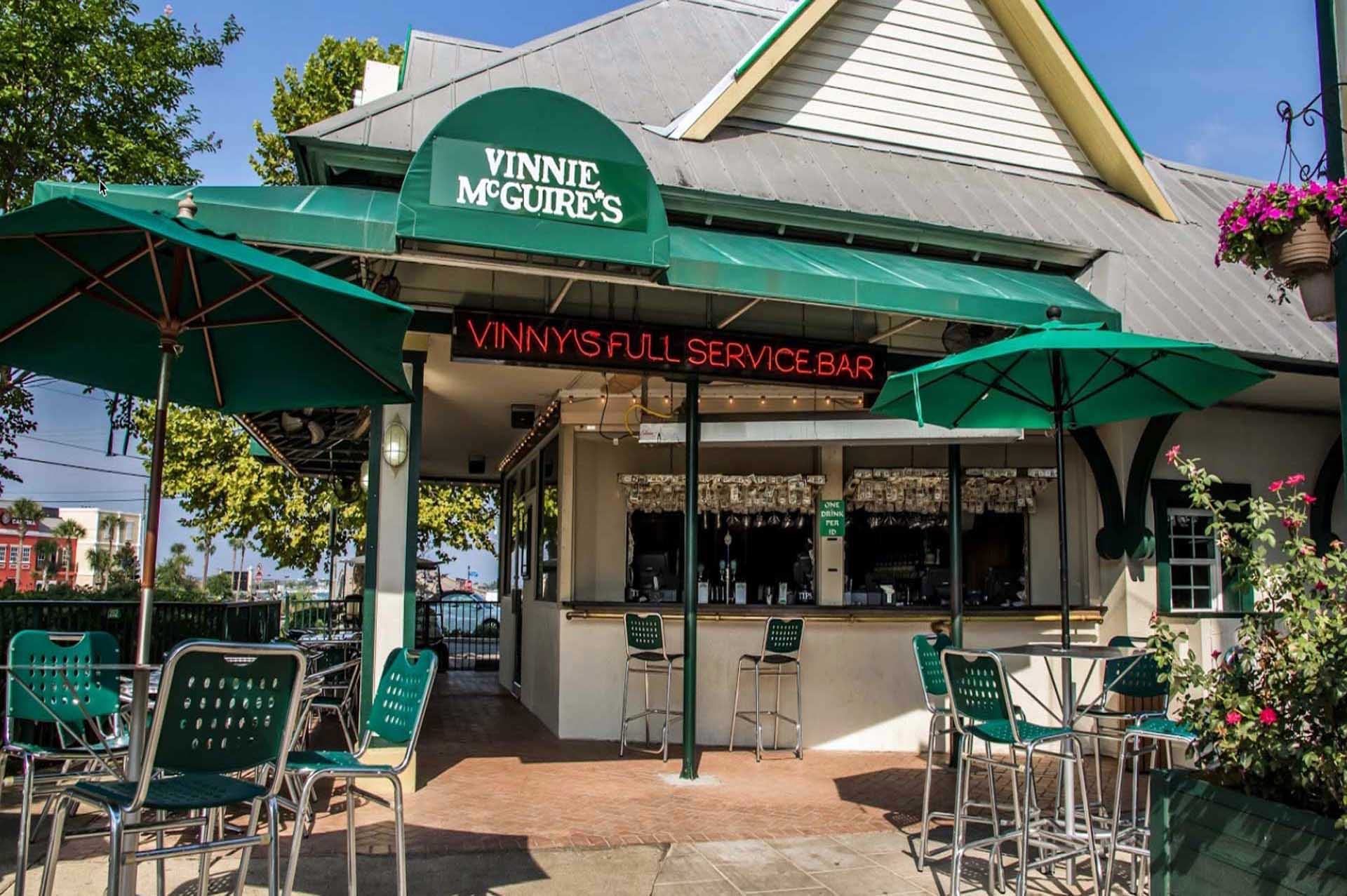 outside front view of Vinny McGuire's Pizza restaurant with patio furniture
