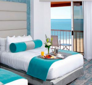 Hotel bed with a view of the beach