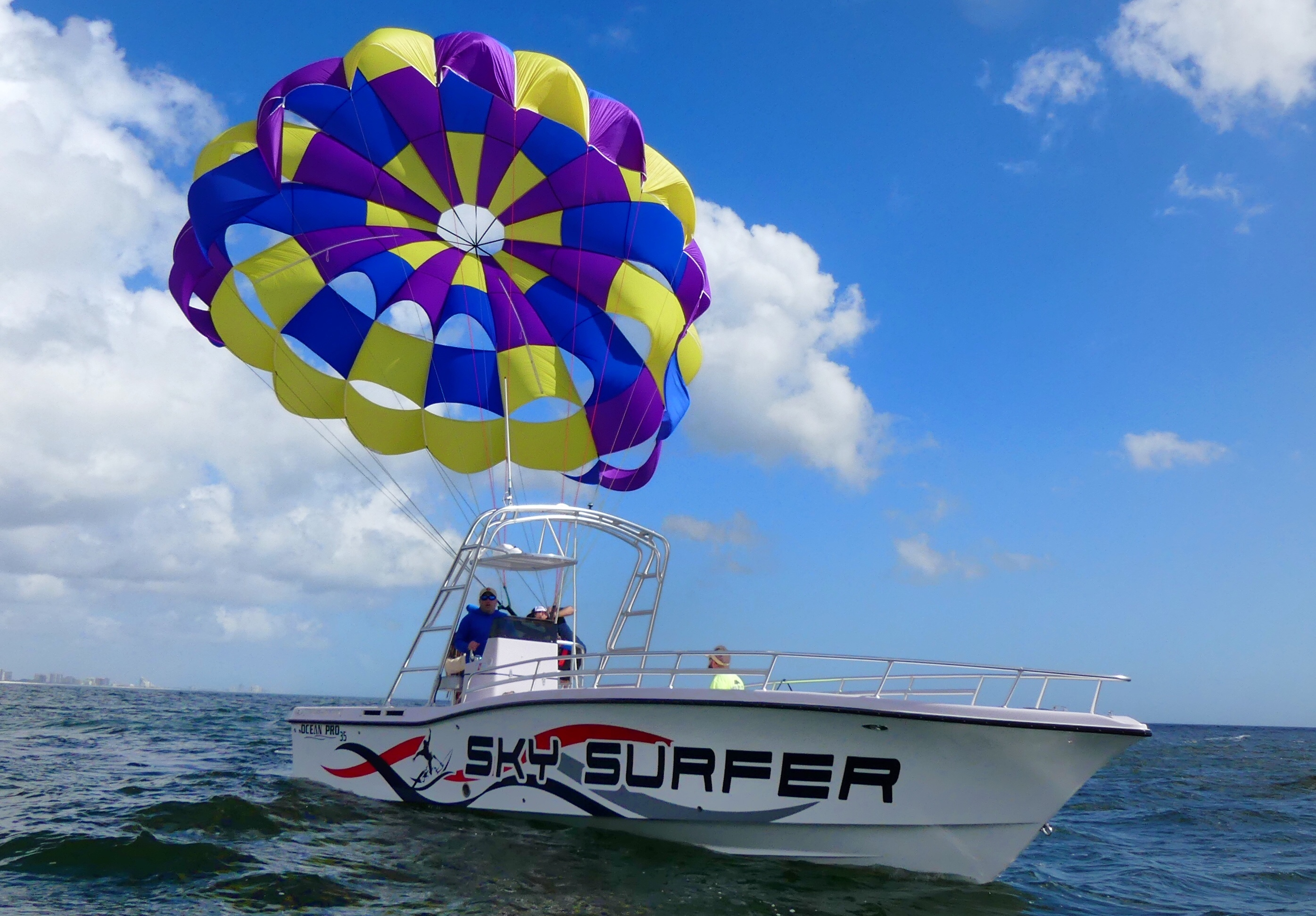 boat carrying a parasail