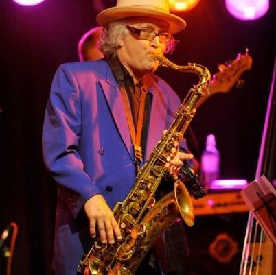 John Lee Sanders playing the saxophone