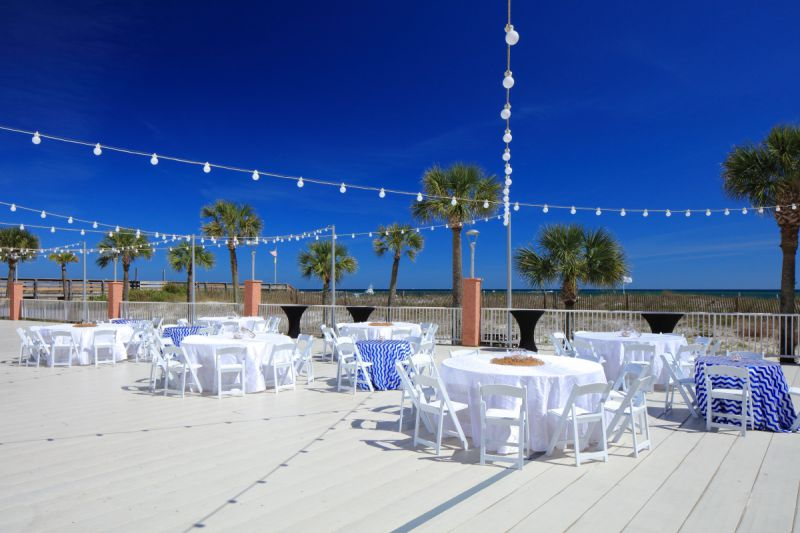 outdoor venue on beachy deck with round tables