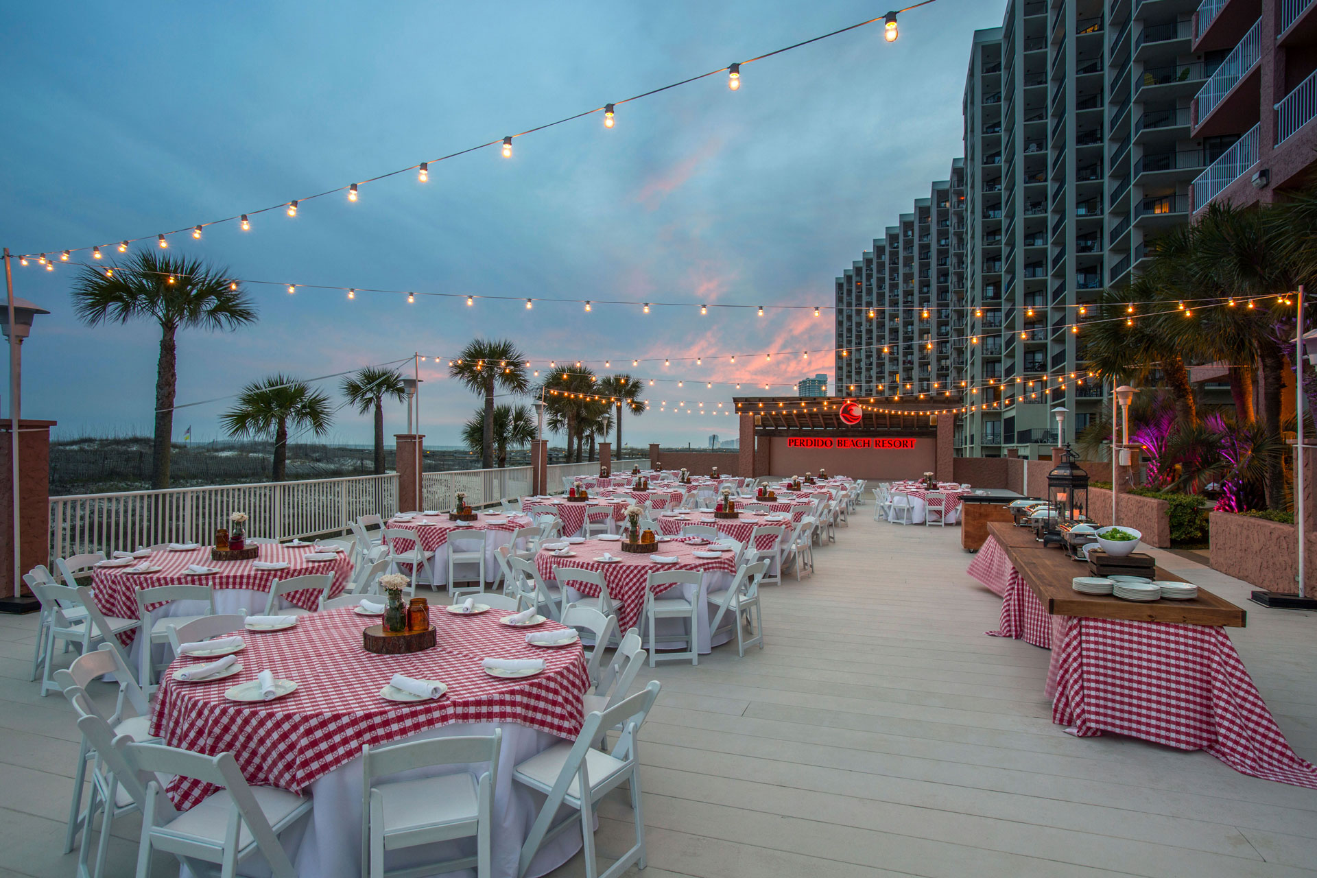 outdoor venue with red checkered decor at sunset