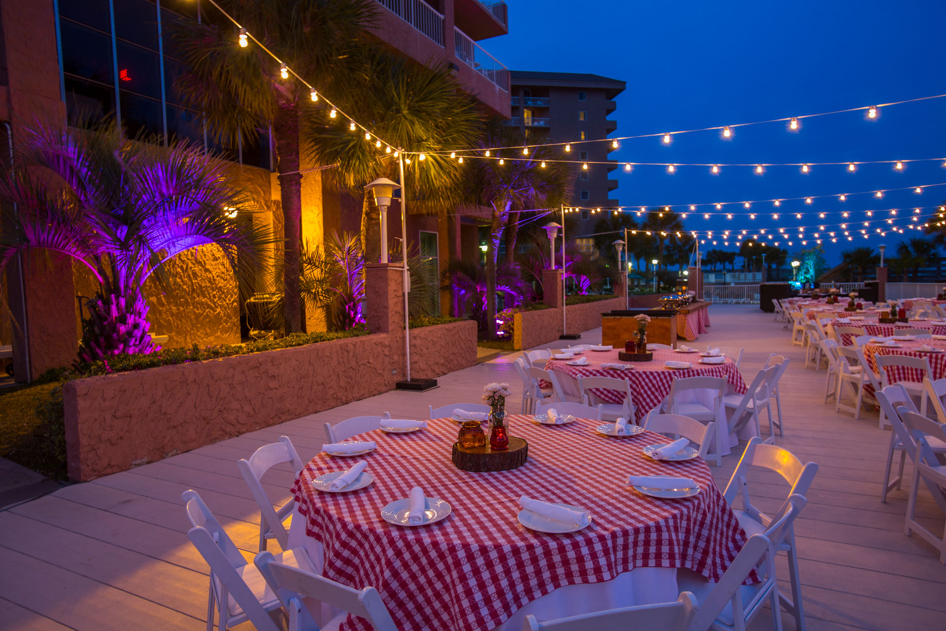 Nighttime outdoor venue with red checkered decor theme