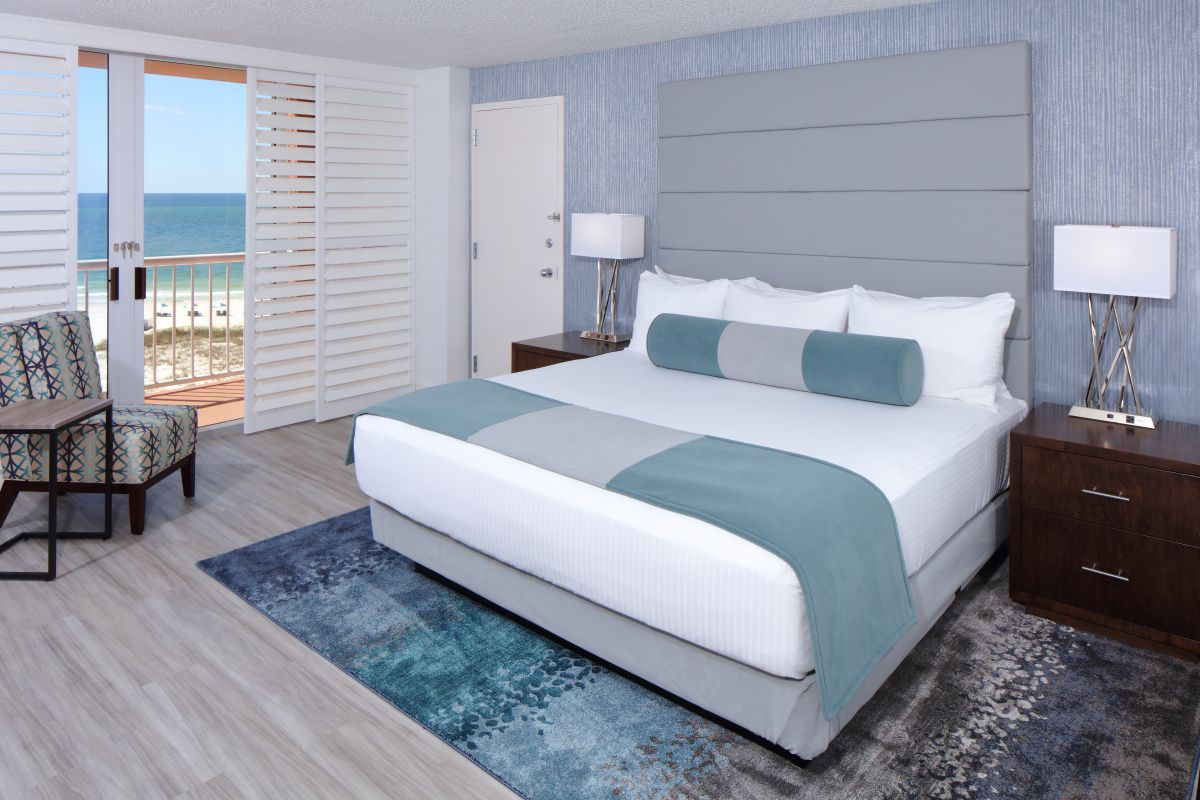 hotel room with king bed and view of the gulf