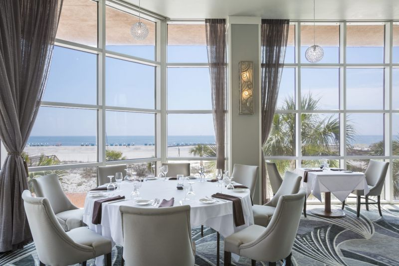 Fine dining interior by big window at Voyagers