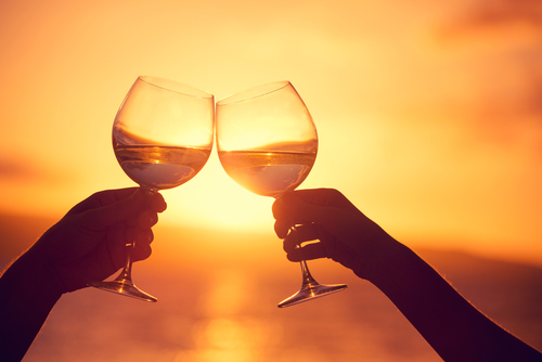 enjoying wine during a beautiful sunset