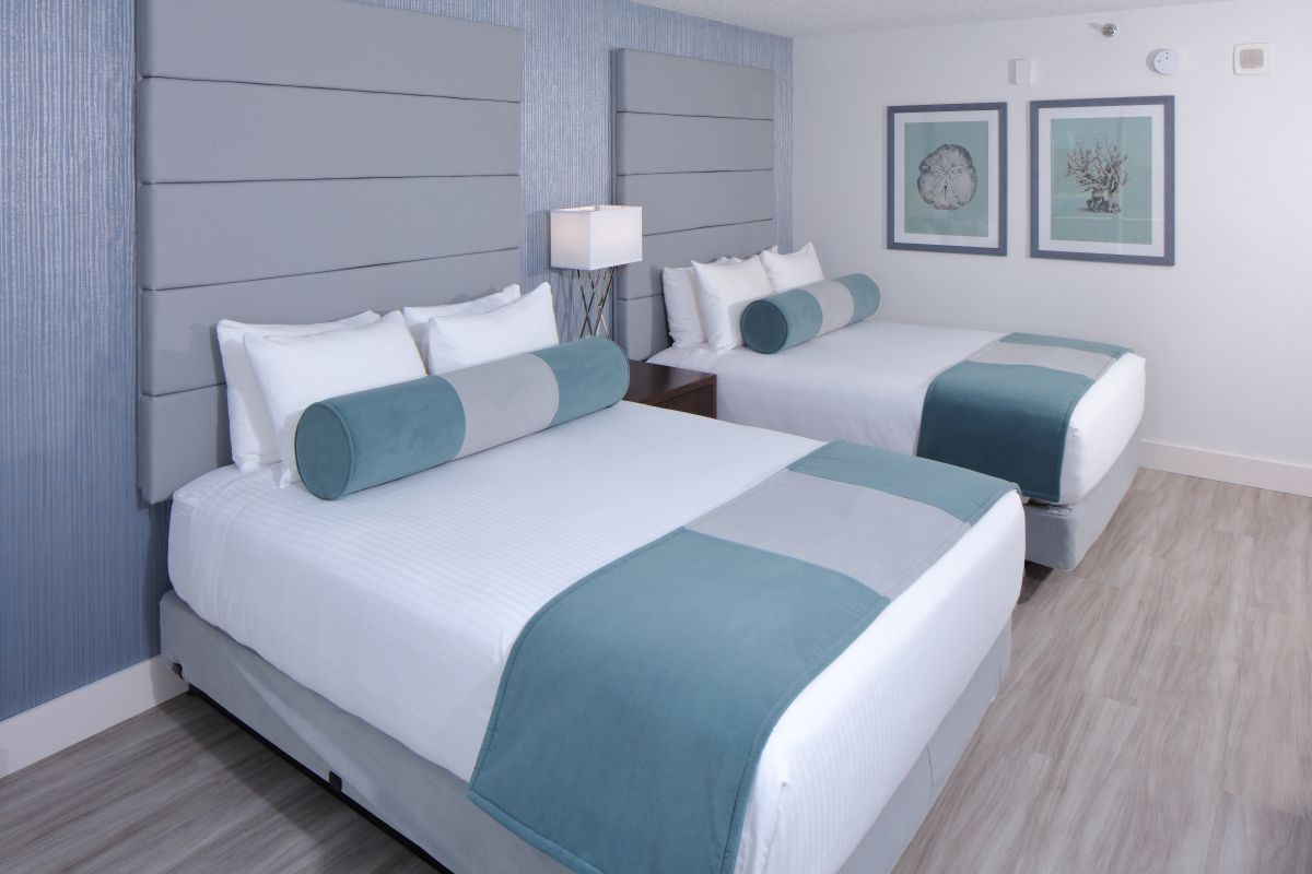 two queen beds featuring silver and blue decor