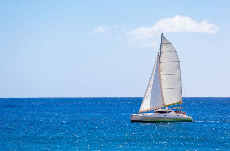 white sailboat on open blue water