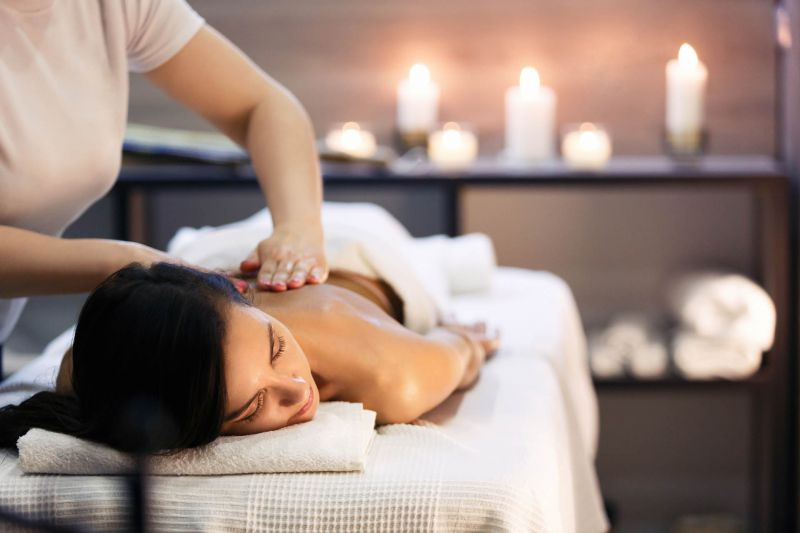 woman on massage table receiving back massage