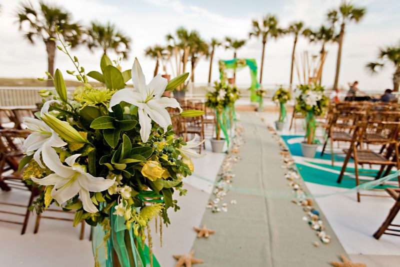tropical decoration around wedding aisle at outdoor event