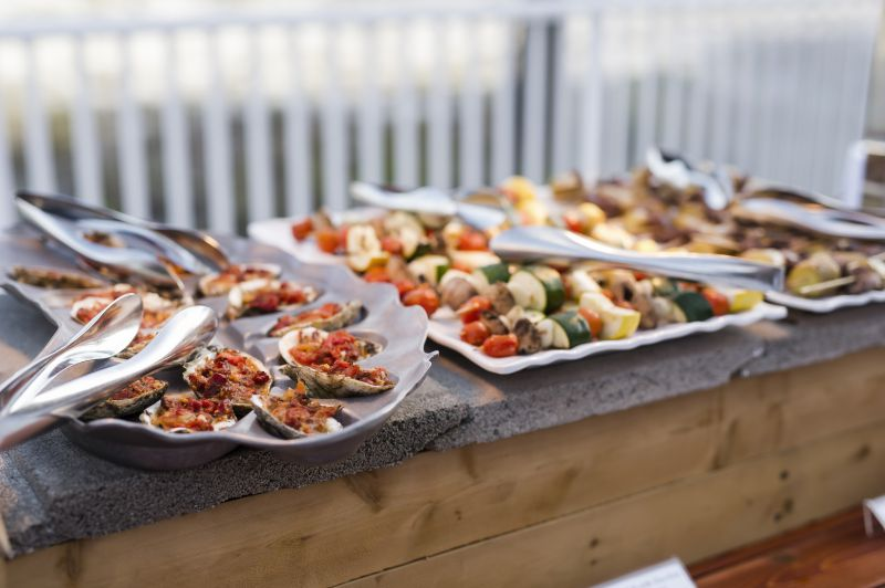 wedding catering featuring platters of hors d'oeuvres on outside table