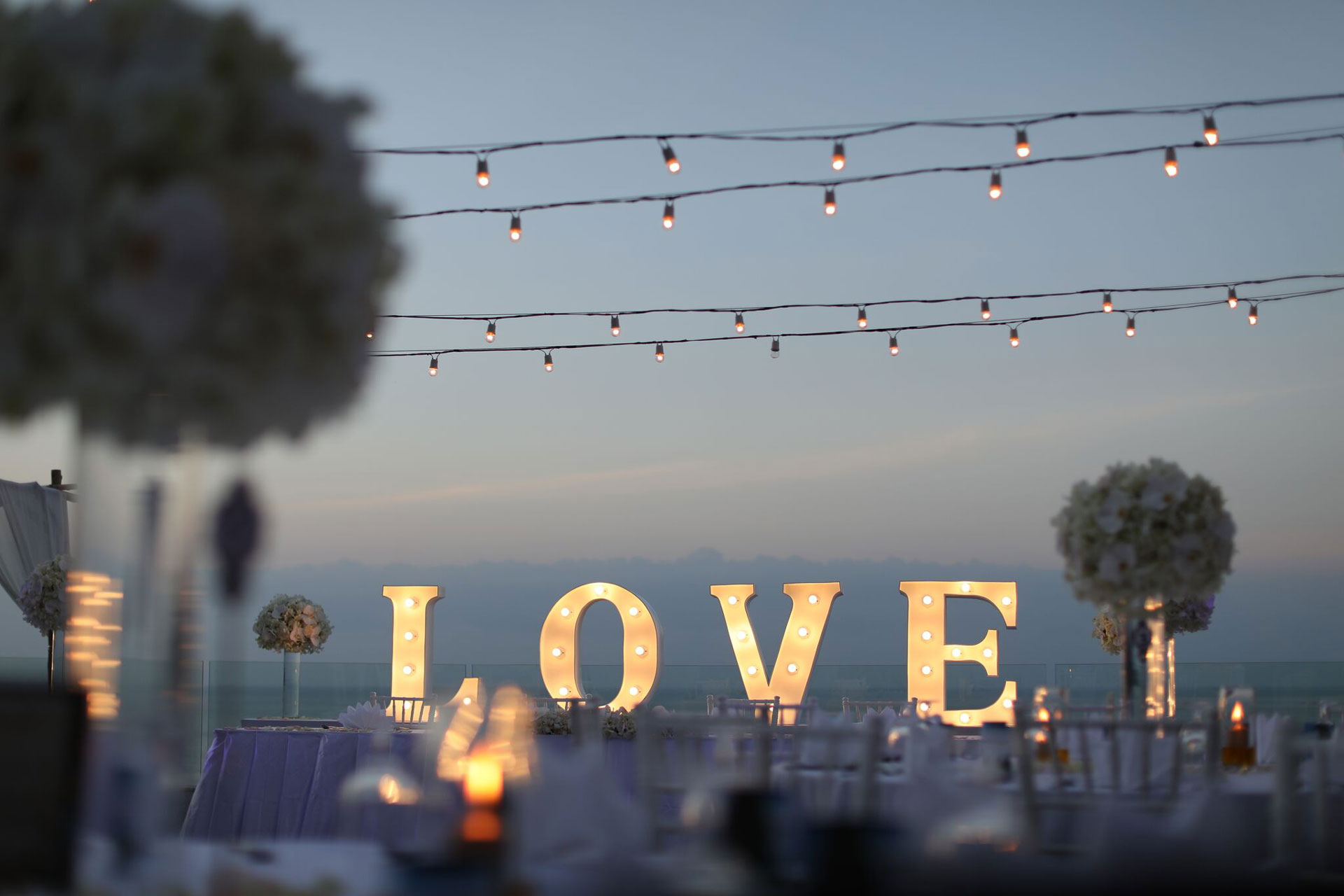 wedding decorations featuring big block letters spelling love on table